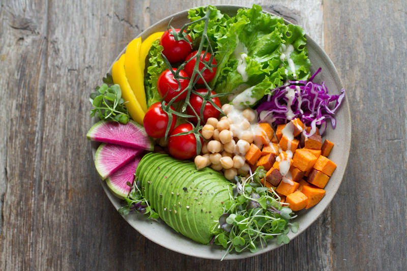 A plate of healthy food brightly coloured and perfect for a healthy long life